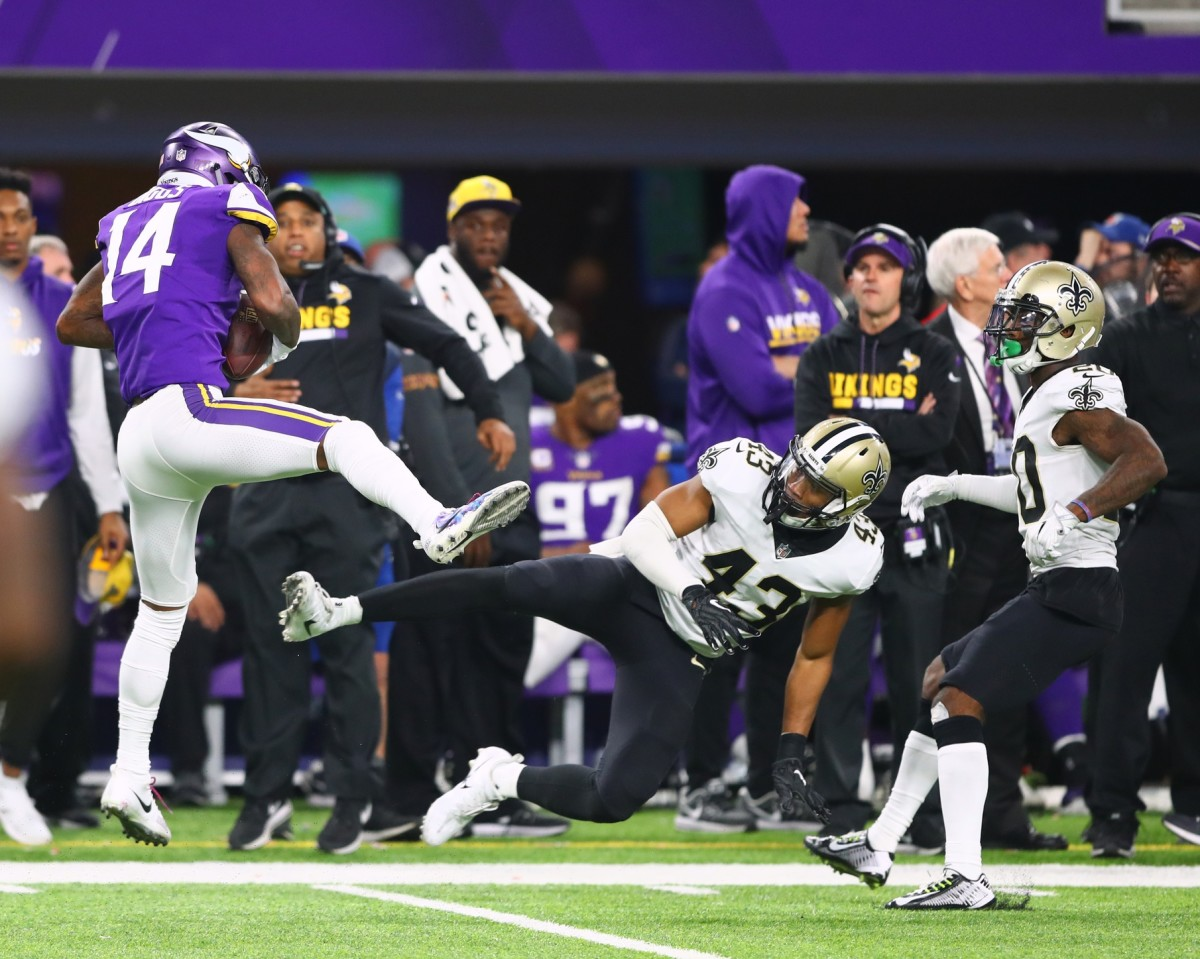 Jan 14, 2018; Minneapolis, MN, USA; Minnesota Vikings wide receiver Stefon Diggs catches the game winning touchdown as New Orleans Saints safety Marcus Williams (43) misses the tackle and collides with cornerback Ken Crawley (20) in the fourth quarter at U.S. Bank Stadium. Mandatory Credit: Mark J. Rebilas-USA TODAY