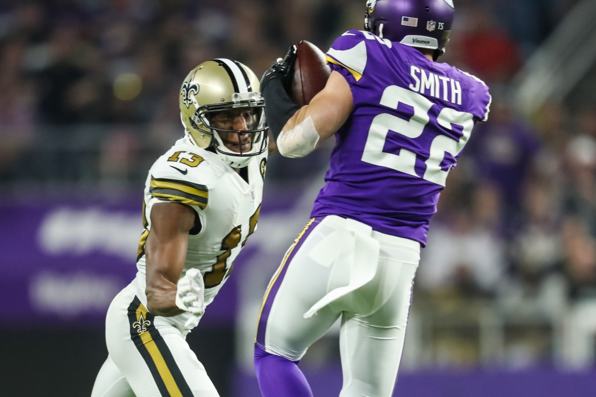 Oct 28, 2018; Minneapolis, MN, USA; Minnesota Vikings safety Harrison Smith (22) intercepts a pass in front of New Orleans Saints wide receiver Michael Thomas (13) during the second quarter at U.S. Bank Stadium. Mandatory Credit: Brace Hemmelgarn-USA TODAY Sports