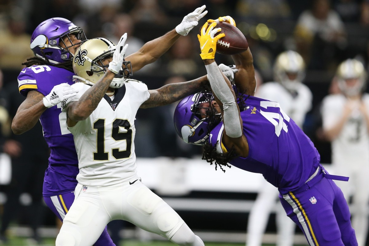 Jan 5, 2020; New Orleans, Louisiana, USA; Minnesota Vikings defensive back Anthony Harris (41) intercepts a pass interned for New Orleans Saints wide receiver Ted Ginn (19) as Minnesota cornerback Trae Waynes (26) backs up the play during the second quarter of a NFC Wild Card playoff football game at the Mercedes-Benz Superdome. Mandatory Credit: Chuck Cook -USA TODAY