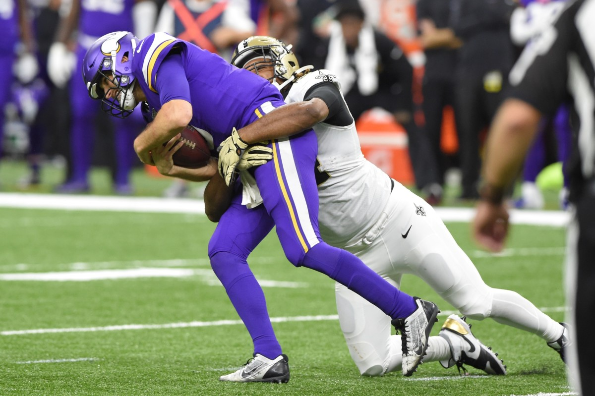 Jan 5, 2020; New Orleans, Louisiana, USA; New Orleans Saints defensive end Cameron Jordan (94) sacks Minnesota Vikings quarterback Kirk Cousins (8) during the fourth quarter of a NFC Wild Card playoff football game at the Mercedes-Benz Superdome. Mandatory Credit: John David Mercer-USA TODAY