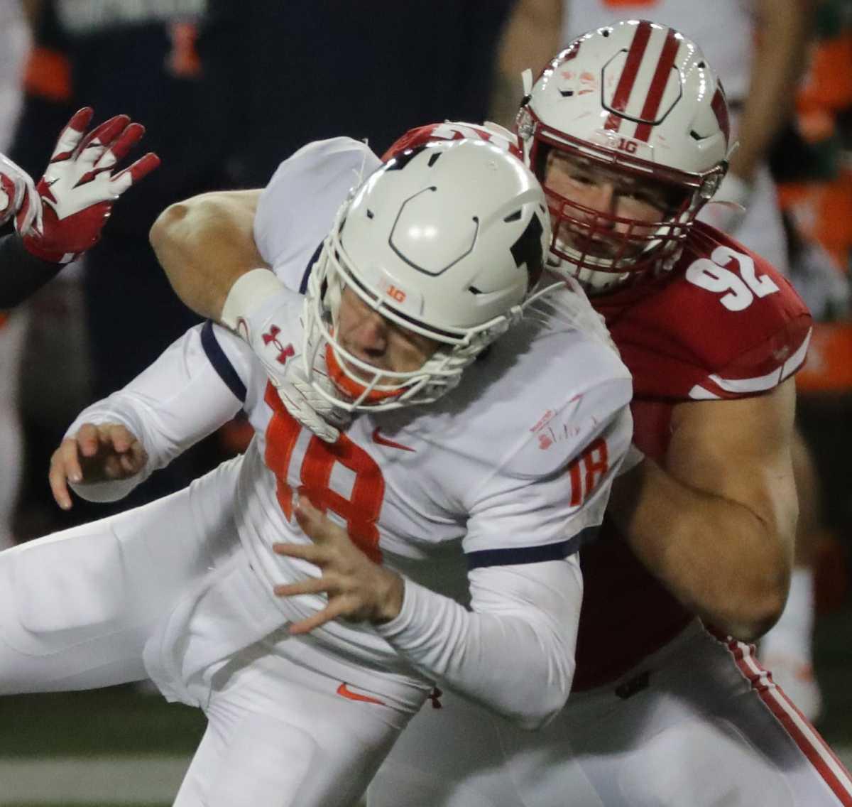 Wisconsin defensive end Matt Henningsen pressures Illinois quarterback Brandon Peters