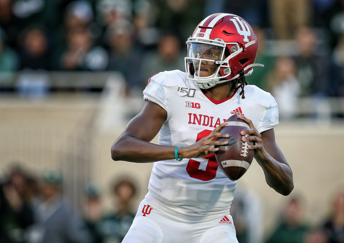 Indiana Hoosiers quarterback Michael Penix Jr. (9) drops back to throw the ball during the first half of a game against the Michigan State Spartans at Spartan Stadium.