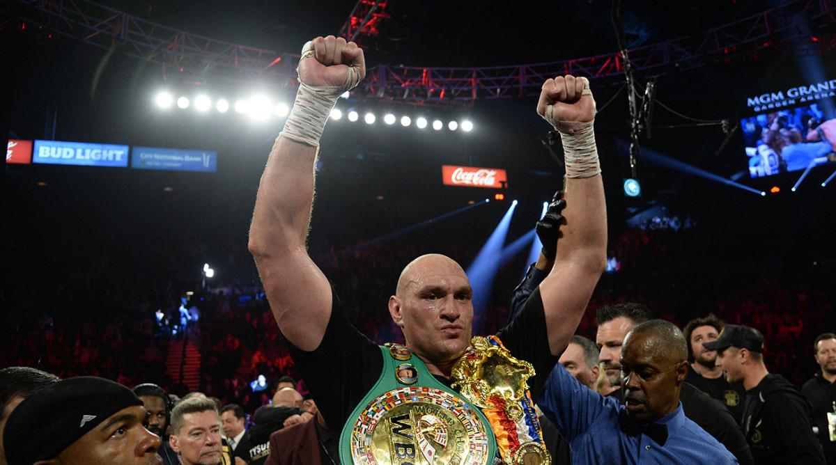 Tyson Fury celebrates his win over Deontay Wilder