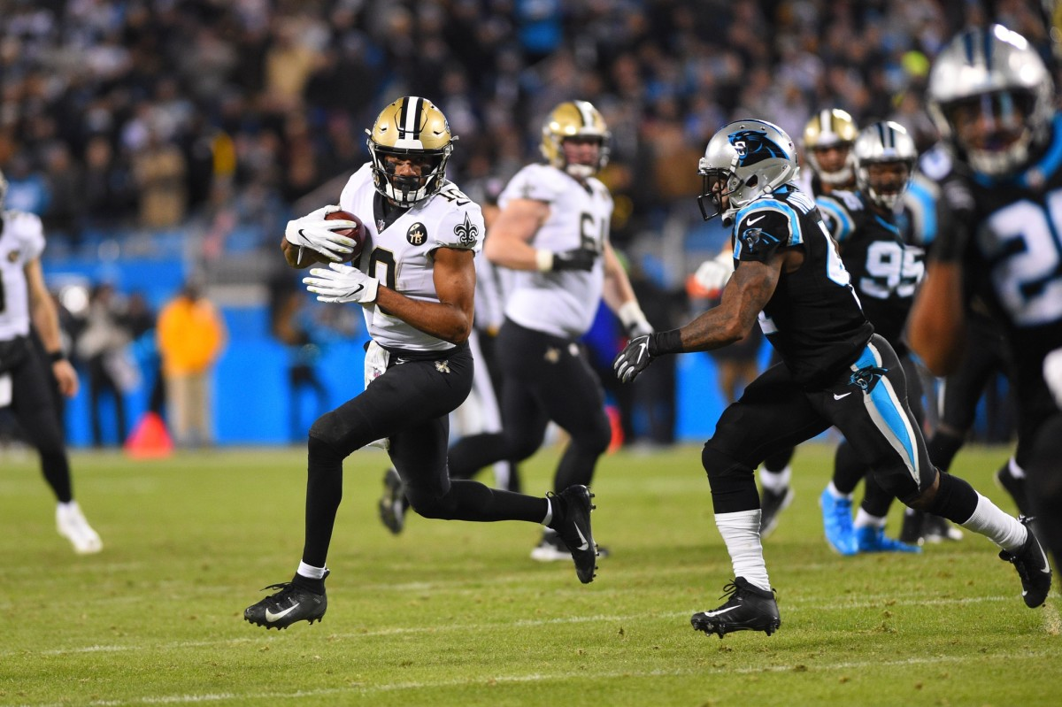 Dec 17, 2018; Charlotte, NC, USA; New Orleans Saints wide receiver Tre'Quan Smith (10) with the ball as Carolina Panthers defensive back Captain Munnerlyn (41) defends in the fourth quarter at Bank of America Stadium. Mandatory Credit: Bob Donnan-USA TODAY