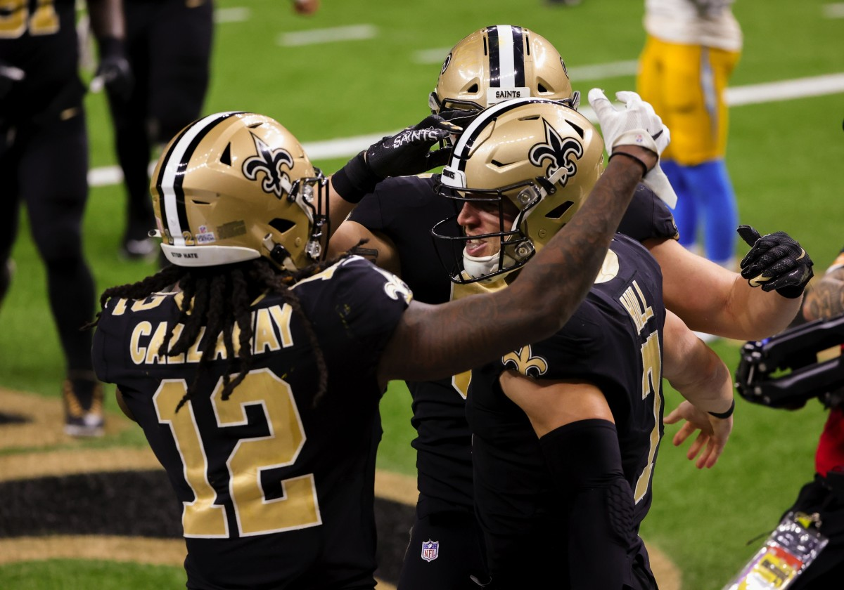 Oct 12, 2020; New Orleans, Louisiana, USA; New Orleans Saints quarterback Taysom Hill (7) celebrates with wide receiver Marquez Callaway (12) after a touchdown run against the Los Angeles Chargers during the fourth quarter at the Mercedes-Benz Superdome. Mandatory Credit: Derick E. Hingle-USA TODAY