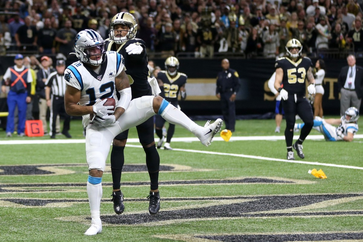 Nov 24, 2019; New Orleans, LA, USA; Carolina Panthers wide receiver D.J. Moore (12) makes a touchdown catch while defended by New Orleans Saints cornerback P.J. Williams (26) in the second half at the Mercedes-Benz Superdome. The Saints won, 34-31. Mandatory Credit: Chuck Cook-USA TODAY