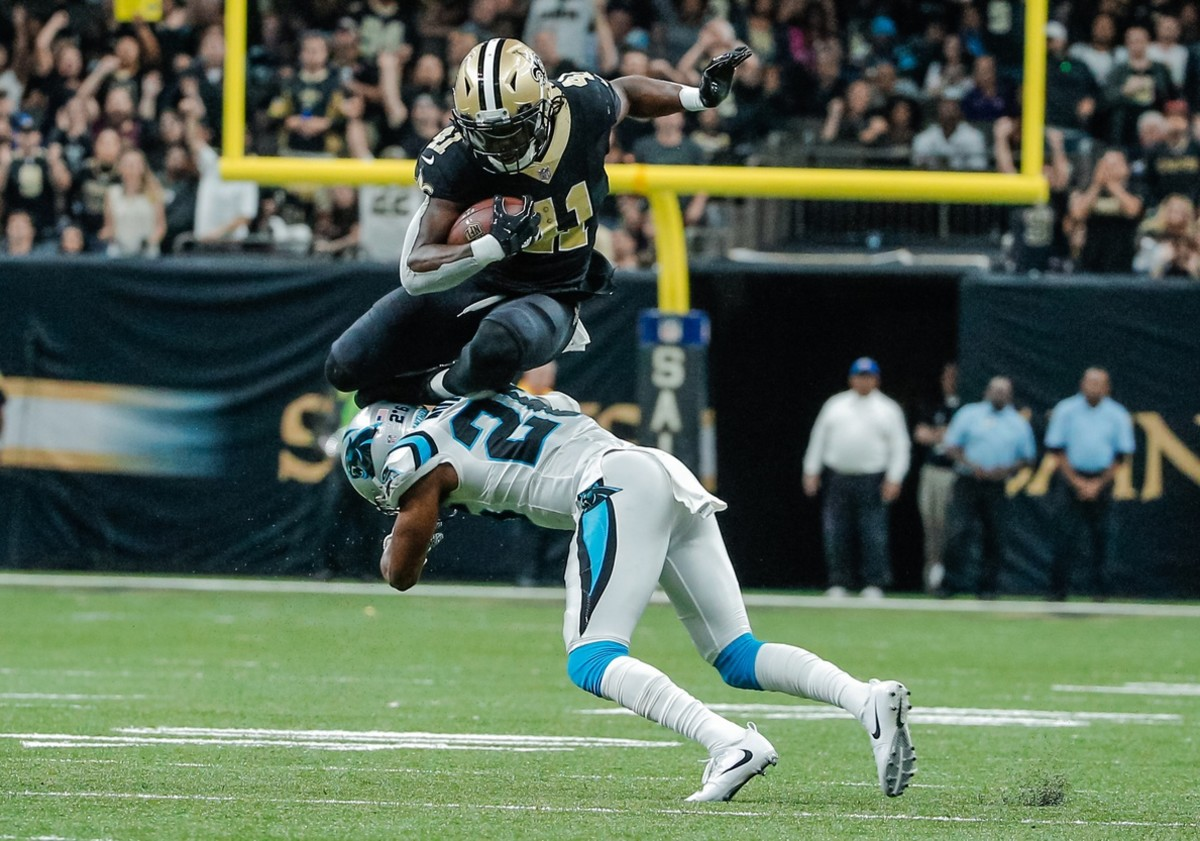 Dec 3, 2017; New Orleans, LA, USA; New Orleans Saints running back Alvin Kamara (41) hurdles over Carolina Panthers cornerback Daryl Worley (26) for a first down during the fourth quarter at the Mercedes-Benz Superdome. The Saints defeated the Panthers 31-21. Mandatory Credit: Derick E. Hingle-USA TODAY