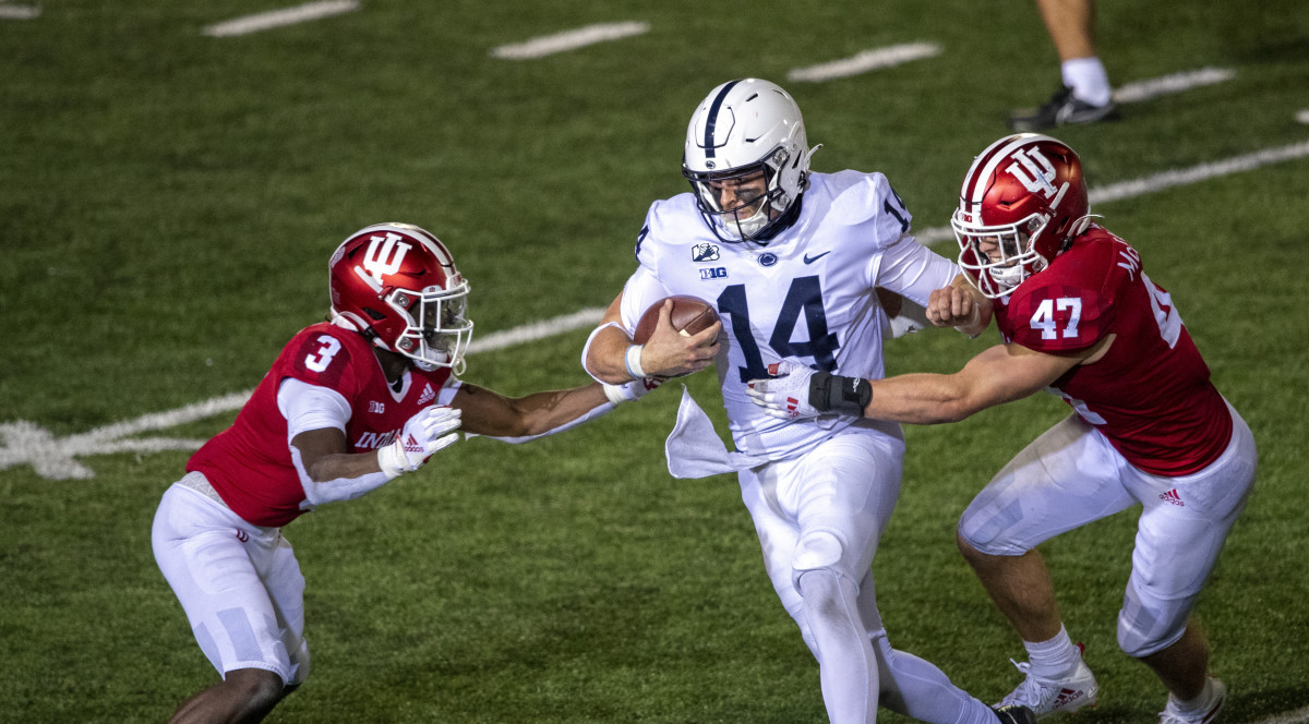 Penn State Nittany Lions quarterback Sean Clifford (14) attempts to avoid tackle from Indiana Hoosiers linebacker Micah McFadden (47) and Indiana Hoosiers defensive back Tiawan Mullen (3) late in the second half of the game at Memorial Stadium.