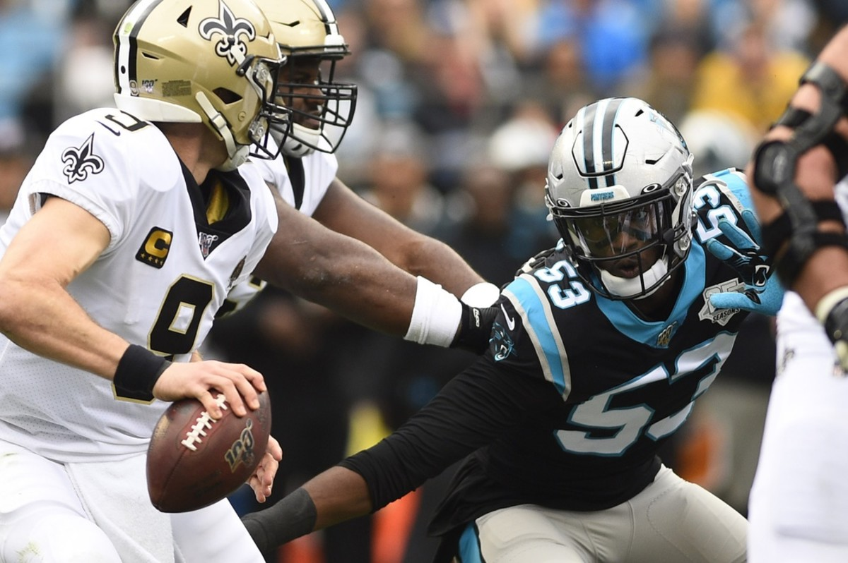 Dec 29, 2019; Charlotte, North Carolina, USA; New Orleans Saints quarterback Drew Brees (9) with the ball as Carolina Panthers linebacker Brian Burns (53) pressures in the first quarter at Bank of America Stadium. Mandatory Credit: Bob Donnan-USA TODAY Sports