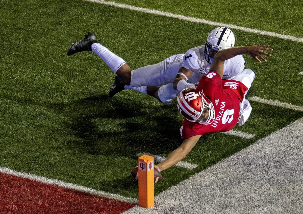 Michael Penix Jr. diving for the pylon, a ruling that ultimately stood in favor of IU.
