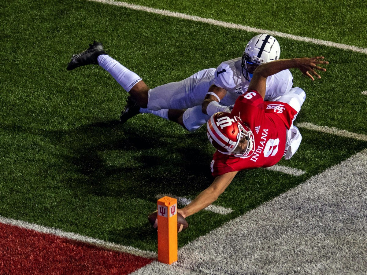 Indiana Hoosiers quarterback Michael Penix Jr. (9) dives with the ball to score a two point conversion and win the game in overtime during the game at Memorial Stadium. The Indiana Hoosiers defeated t...