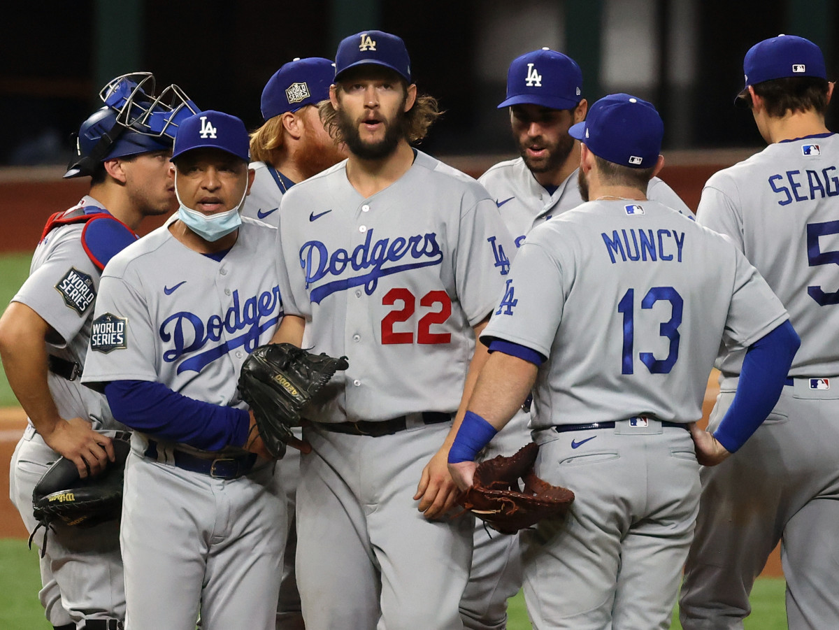 Los Angeles Dodgers manager Dave Roberts (30) takes starting pitcher Clayton Kershaw (22) out of the game during the sixth inning during game five of the 2020 World Series at Globe Life Field.