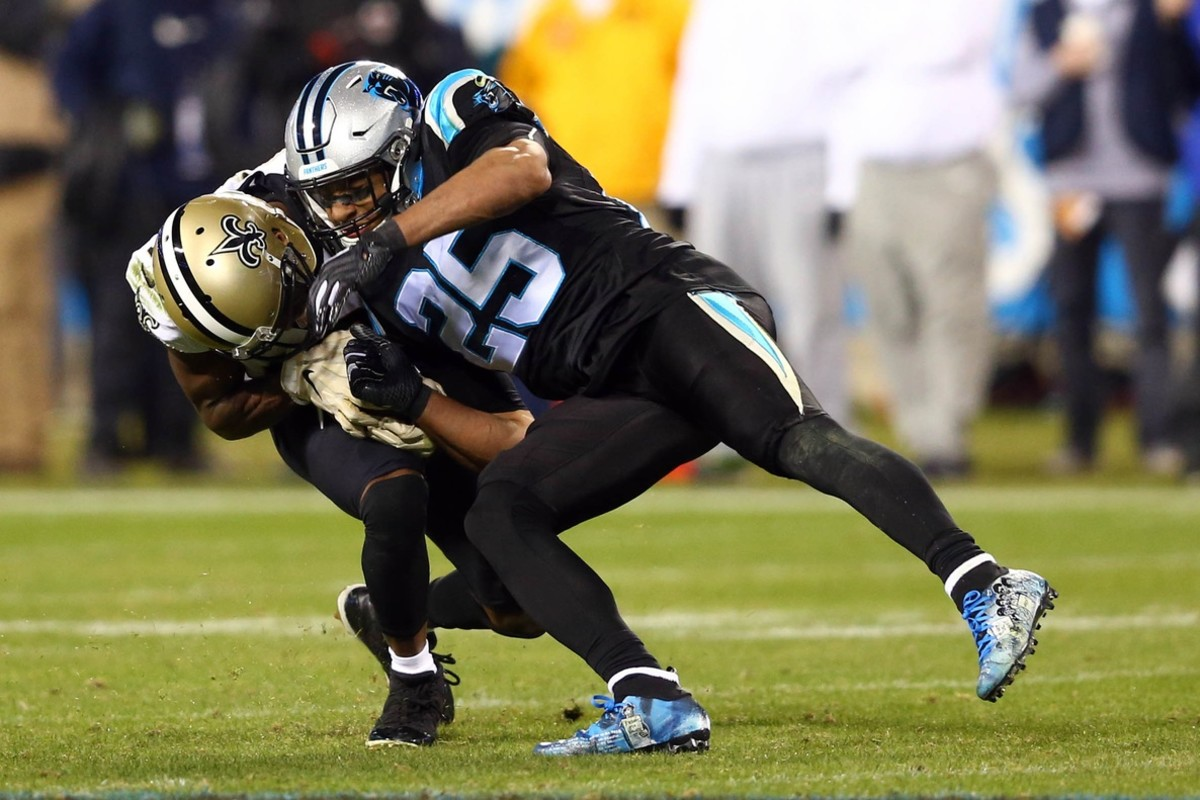 Dec 17, 2018; Charlotte, NC, USA; New Orleans Saints wide receiver Michael Thomas (13) gets hit by Carolina Panthers strong safety Eric Reid (25) during the third quarter at Bank of America Stadium. Mandatory Credit: Jeremy Brevard-USA TODAY