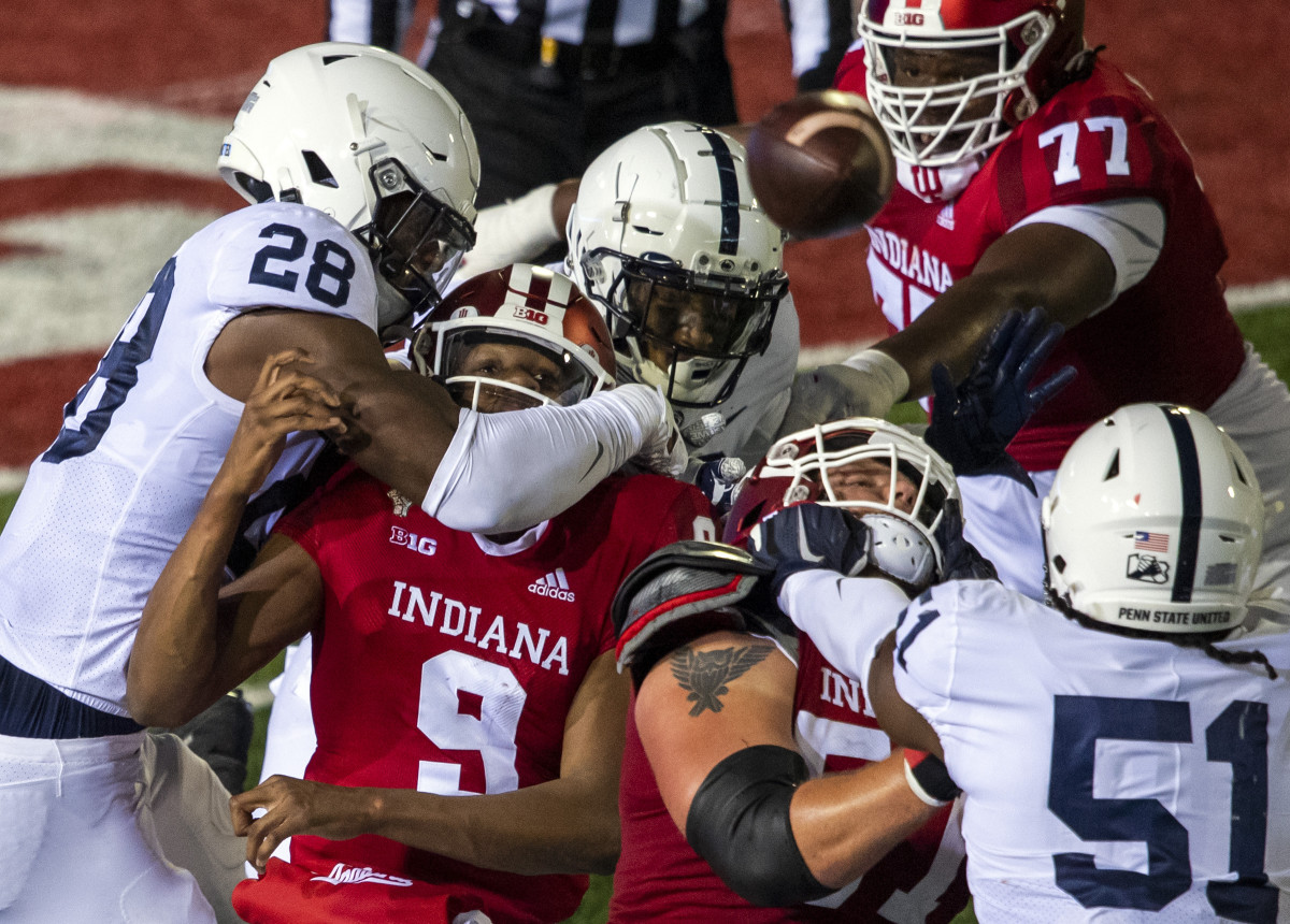 Indiana Hoosiers quarterback Michael Penix Jr. (9) watches his pass while being tackled during the second half of the game at Memorial Stadium.
