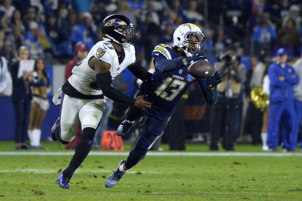 Dec 22, 2018; Carson, CA, USA; Los Angeles Chargers wide receiver Keenan Allen (13) cannot make a catch as Baltimore Ravens strong safety Tony Jefferson (23) defends during the second quarter at StubHub Center. Mandatory Credit: Jake Roth-USA TODAY Sports
