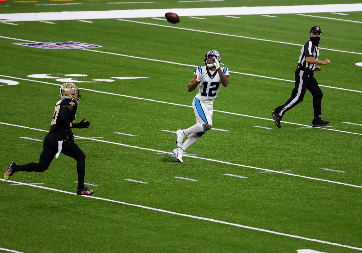 Oct 25, 2020; New Orleans, Louisiana, USA; Carolina Panthers wide receiver D.J. Moore (12) catches a touchdown against the New Orleans Saints during the second quarter at the Mercedes-Benz Superdome. Mandatory Credit: Derick E. Hingle-USA TODAY