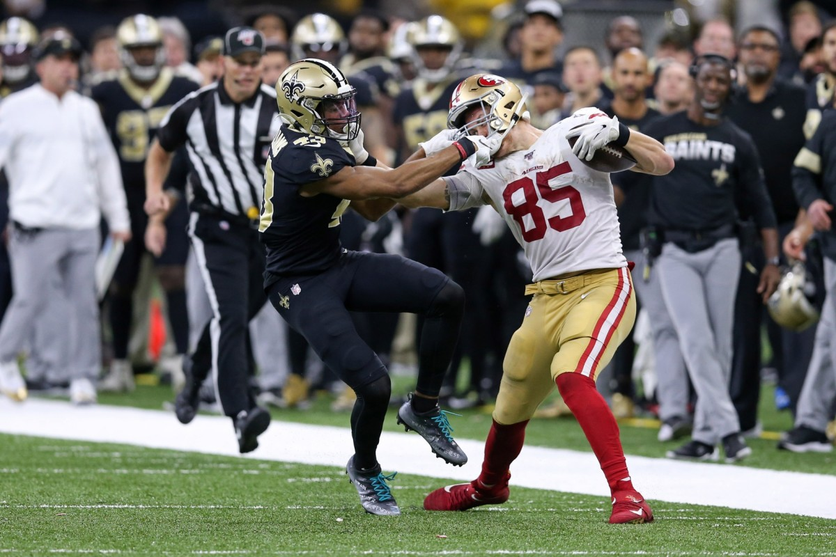 Dec 8, 2019; New Orleans, LA, USA; San Francisco 49ers tight end George Kittle (85) is defended by New Orleans Saints free safety Marcus Williams (43) after a reception late in the fourth quarter at the Mercedes-Benz Superdome. The 49ers won, 48-46. Mandatory Credit: Chuck Cook-USA TODAY Sports