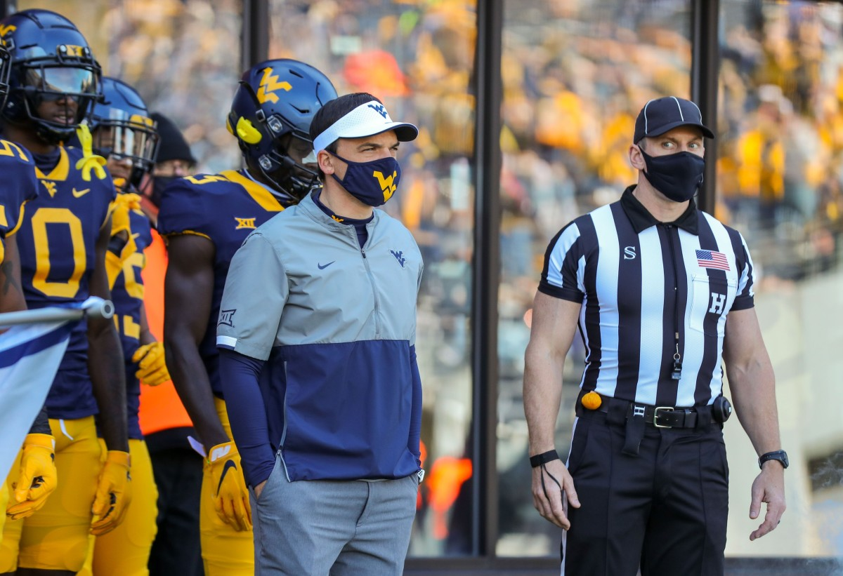 West Virginia Mountaineers head coach Neal Brown pauses before his team runs onto the field before their game against the Kansas Jayhawks at Mountaineer Field at Milan Puskar Stadium.