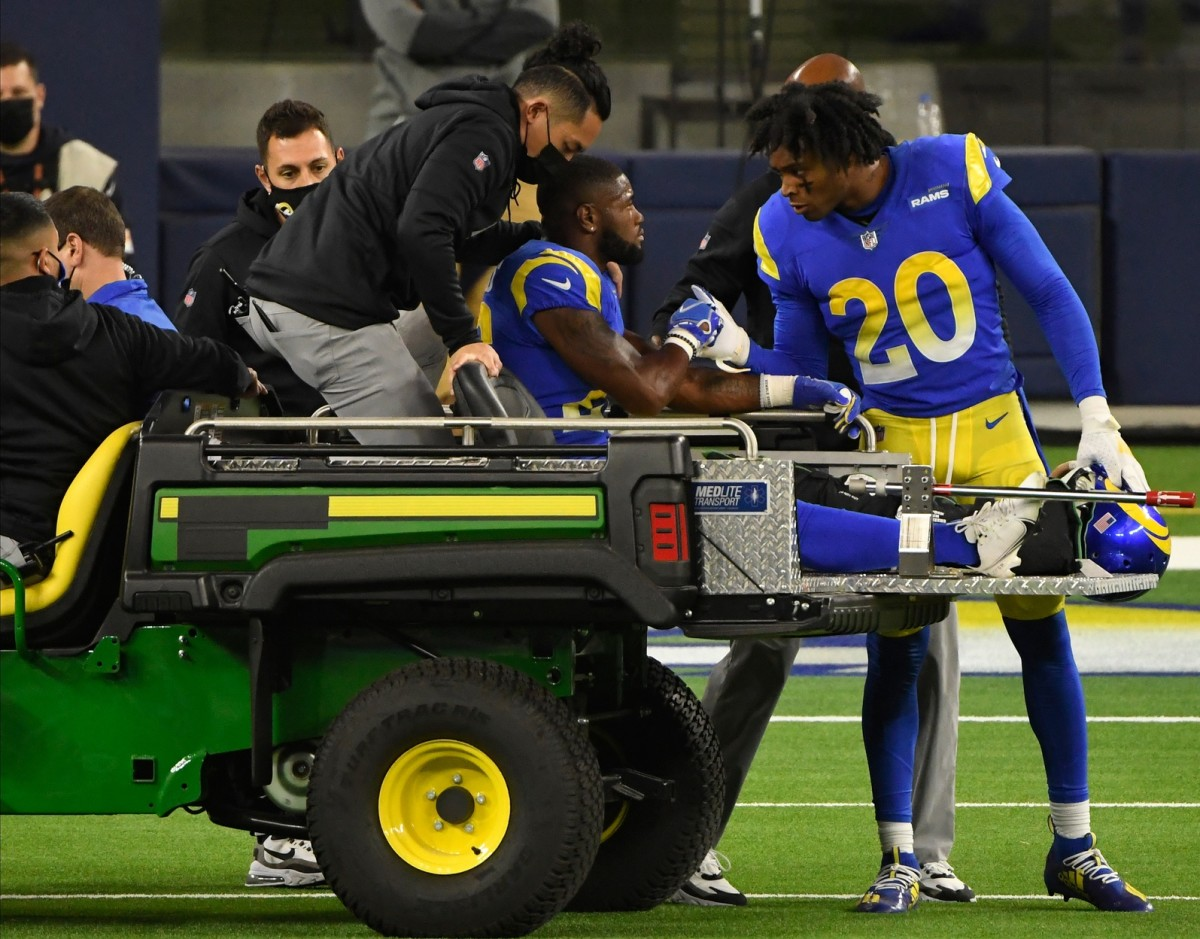 Oct 26, 2020; Inglewood, California, USA; Los Angeles Rams cornerback Jalen Ramsey (20) talks to Los Angeles Rams safety Terrell Burgess (26) before he is driven off the field after injuring his leg in the fourth quarter against the Chicago Bears at SoFi Stadium.