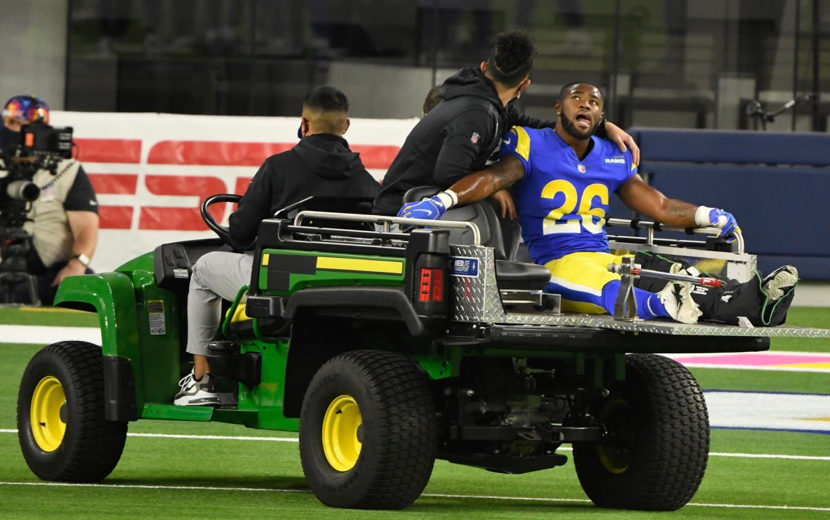 Oct 26, 2020; Inglewood, California, USA; Los Angeles Rams safety Terrell Burgess (26) is drive off the field after injuring a leg in the fourth quarter against the Chicago Bears at SoFi Stadium.