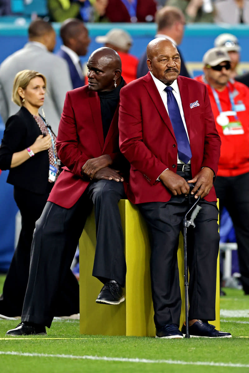 NFL 100 All-Time Team members Lawrence Taylor (left) and Jim Brown before Super Bowl LIV between the 49ers and the Chiefs at Hard Rock Stadium, Feb. 2, 2020