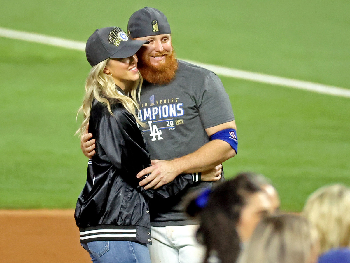 Oct 27, 2020; Arlington, Texas, USA; Los Angeles Dodgers third baseman Justin Turner (10) poses for a picture with his wife Kourtney Pogue after the Los Angeles Dodgers beat the Tampa Bay Rays to win the World Series in game six of the 2020 World Series at Globe Life Field.