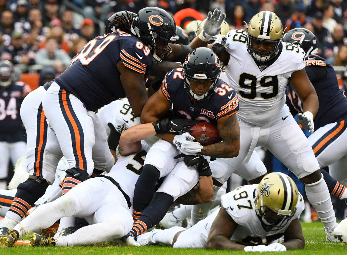 Oct 20, 2019; Chicago, IL, USA; New Orleans Saints linebacker Josh Martin (95) makes a tackle on Chicago Bears running back David Montgomery (32) during the first half at Soldier Field. Mandatory Credit: Mike DiNovo-USA TODAY Sports