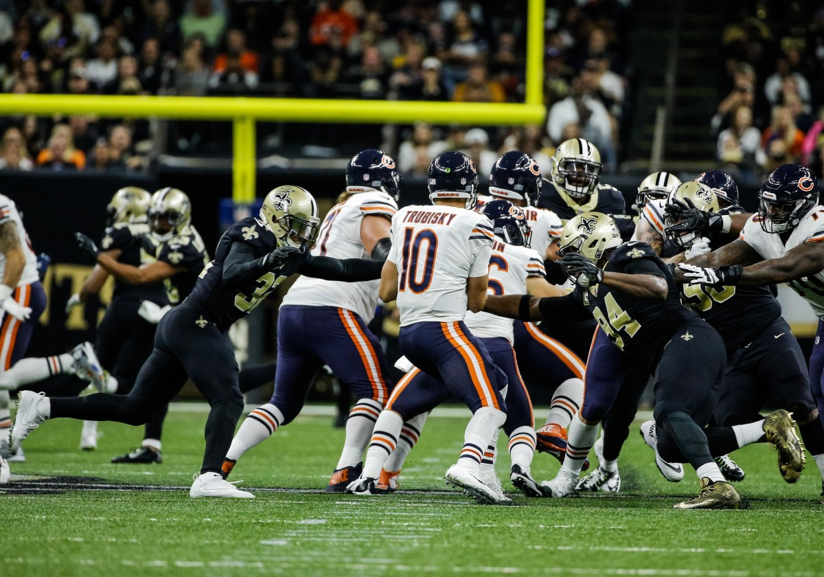 Oct 29, 2017; New Orleans, LA, USA; Chicago Bears quarterback Mitchell Trubisky (10) is sacked by New Orleans Saints safety Kenny Vaccaro (32) and defensive end Cameron Jordan (94) during the first half of a game at the Mercedes-Benz Superdome. Mandatory Credit: Derick E. Hingle-USA TODAY Sports
