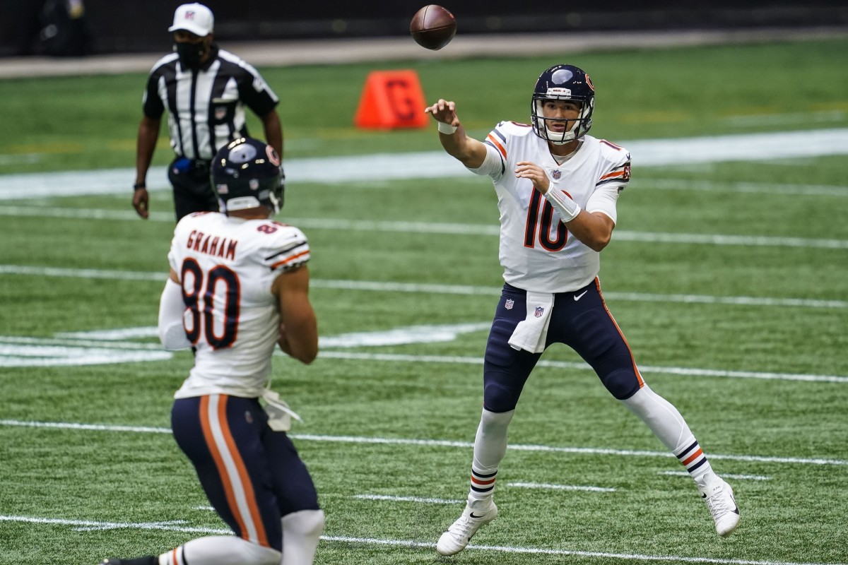 Sep 27, 2020; Atlanta, Georgia, USA; Chicago Bears quarterback Mitchell Trubisky (10) throws a pass to tight end Jimmy Graham (80) against the Atlanta Falcons during the first quarter at Mercedes-Benz Stadium. Mandatory Credit: Dale Zanine-USA TODAY