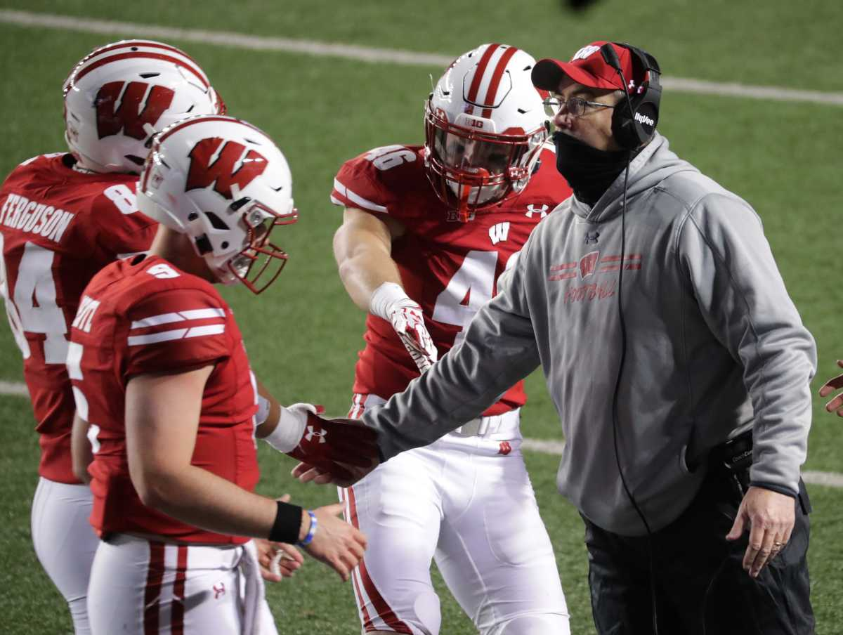 Wisconsin head coach Paul Chryst congratulates his team after a touchdown against Illinois on Oct. 23. Wisconsin defeated Illinois 45-7 on that Friday night opener for the Big Ten Conference.