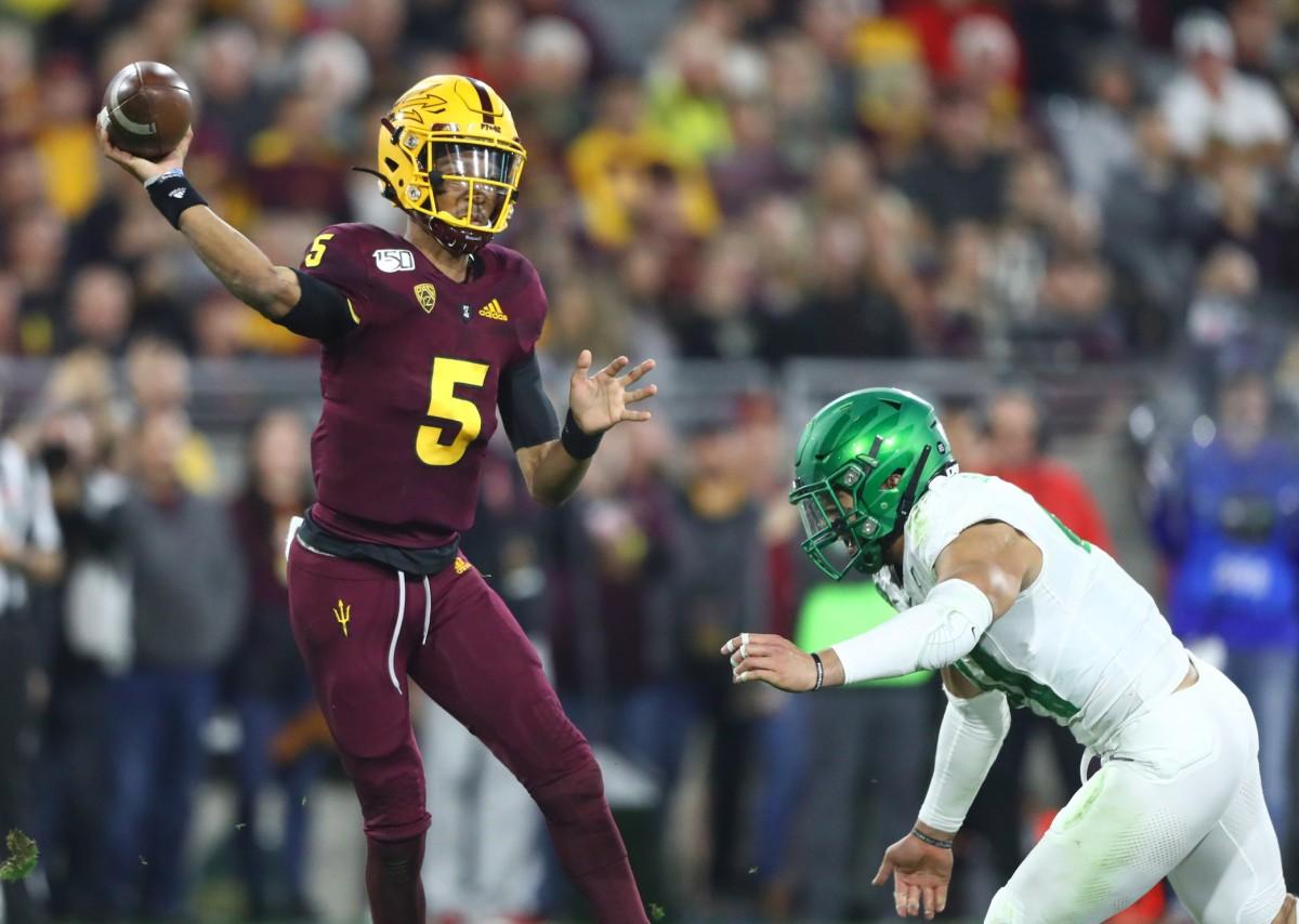 Nov 23, 2019; Tempe, AZ, USA; Arizona State Sun Devils quarterback Jayden Daniels (5) throws a pass in the second half against the Oregon Ducks at Sun Devil Stadium.