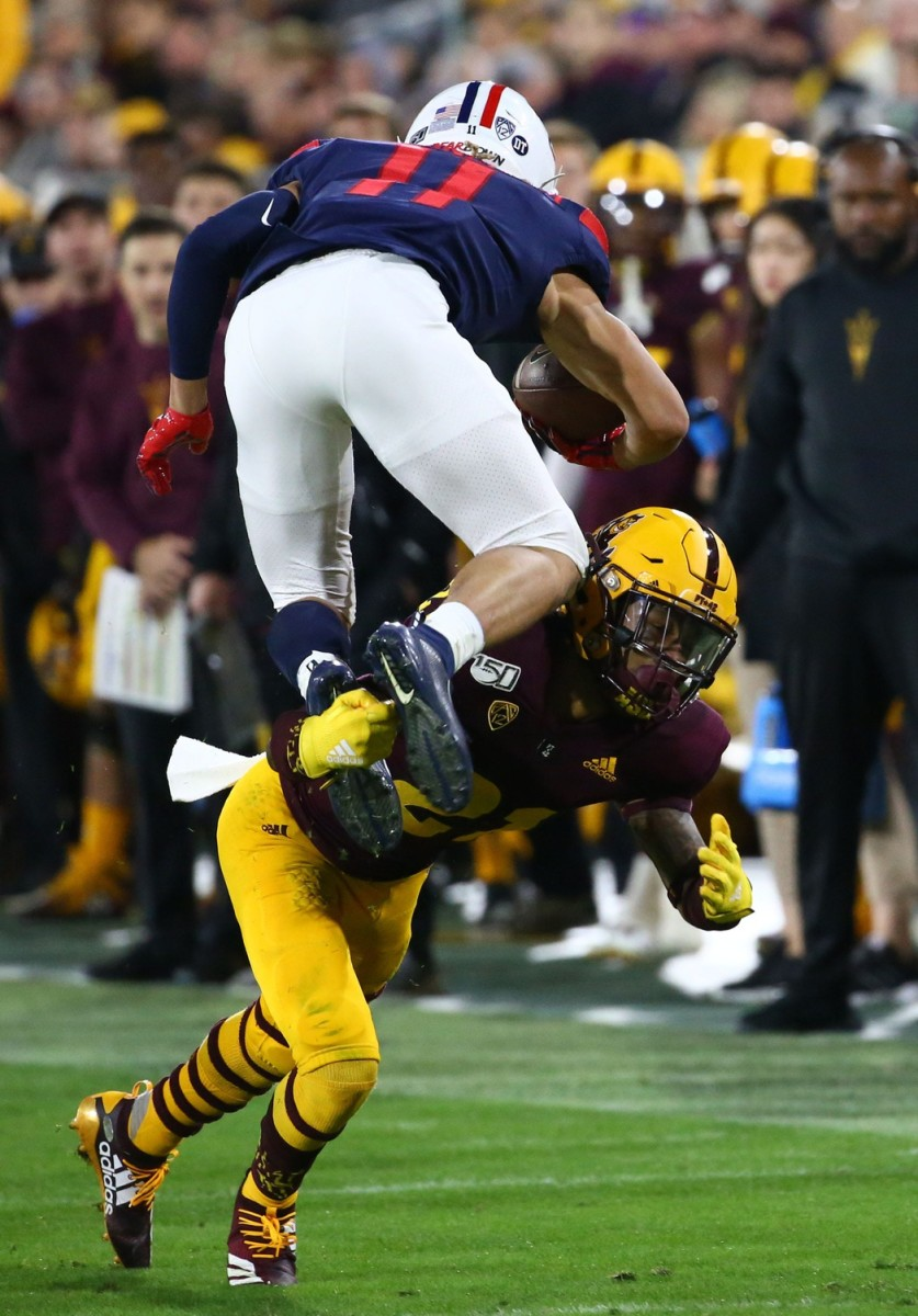 Arizona State Sun Devils defensive back Jack Jones (21) tackles Arizona Wildcats wide receiver Tayvian Cunningham (11) in the first half of the 93rd Duel in the Desert on Nov. 30, 2019 in Tempe, Ariz. Arizona Wildcats Vs Arizona State Sun Devils