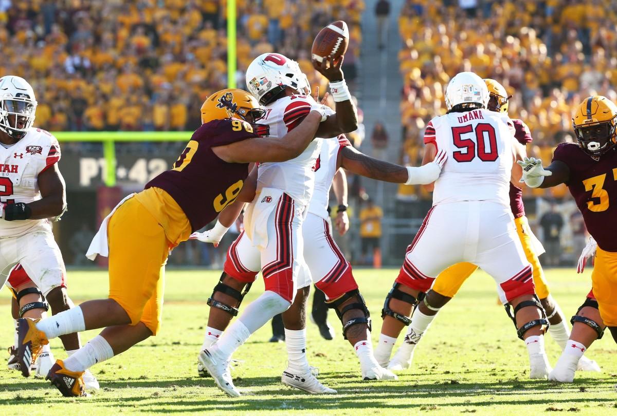 Arizona State defensive lineman Jermayne Lole forces a fumble by Utah quarterback Jason Shelley in the second half on Nov. 3 at Sun Devil Stadium. Utah Vs Arizona State 2018