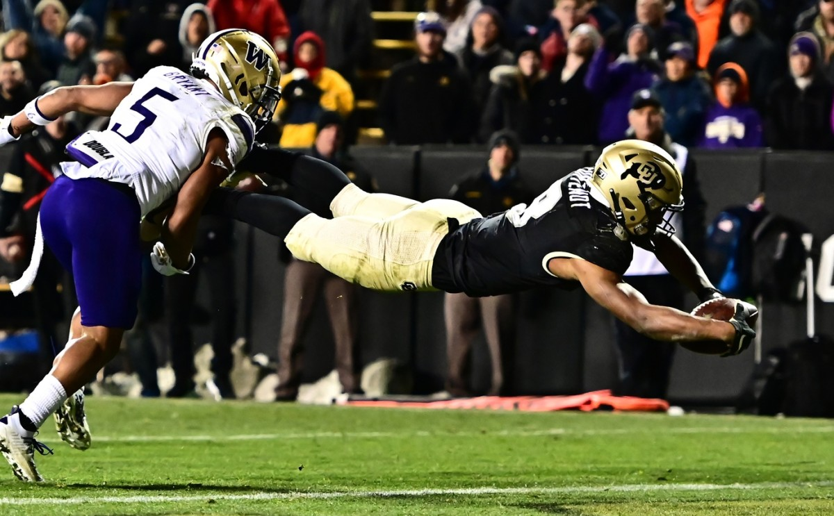 Nov 23, 2019; Boulder, CO, USA; Colorado Buffaloes running back Alex Fontenot (8) dives for a touchdown against Washington Huskies defensive back Myles Bryant (5) in the third quarter at Folsom Field.