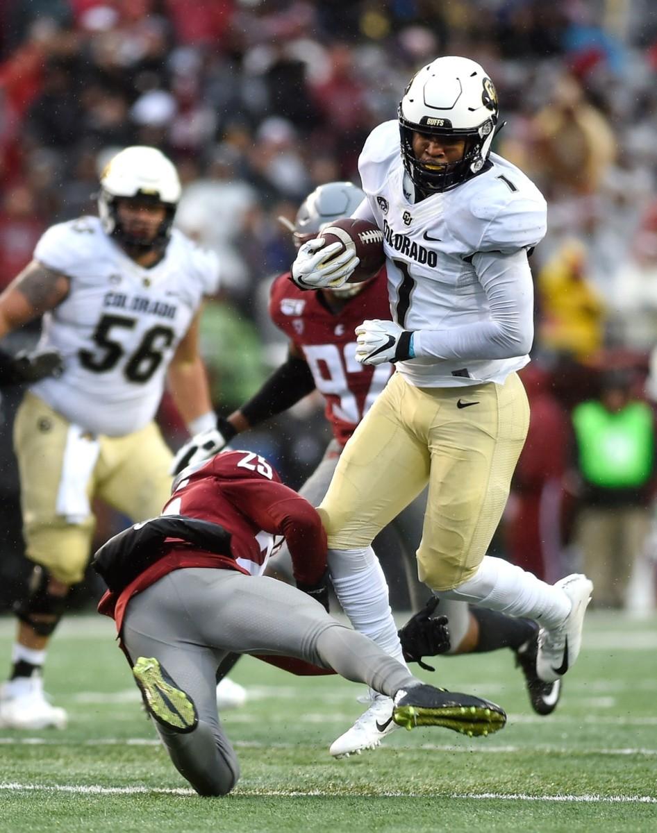 Oct 19, 2019; Pullman, WA, USA; Colorado Buffaloes running back Jaren Mangham (1) avoids the tackle of Washington State Cougars safety Skyler Thomas (25) in the first at Martin Stadium.
