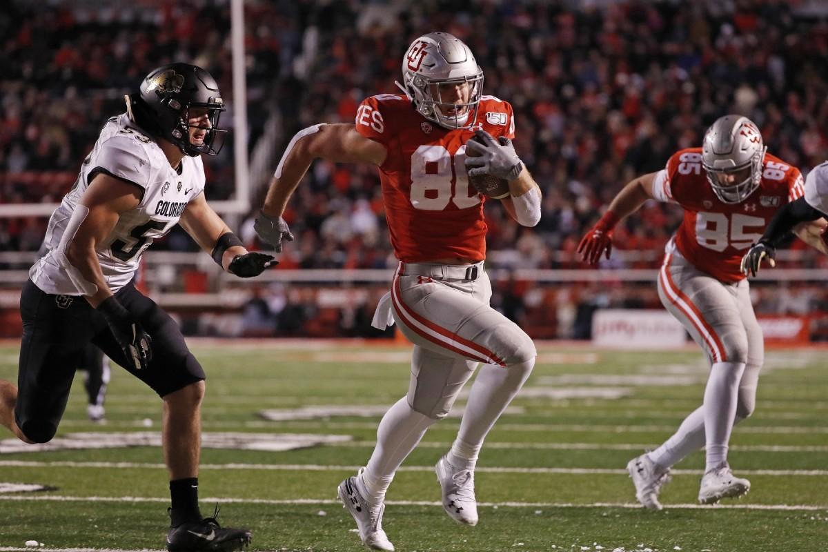 Nov 30, 2019; Salt Lake City, UT, USA; Utah Utes tight end Brant Kuithe (80) past Colorado Buffaloes linebacker Nate Landman (53) for a fourth quarter touchdown at Rice-Eccles Stadium.