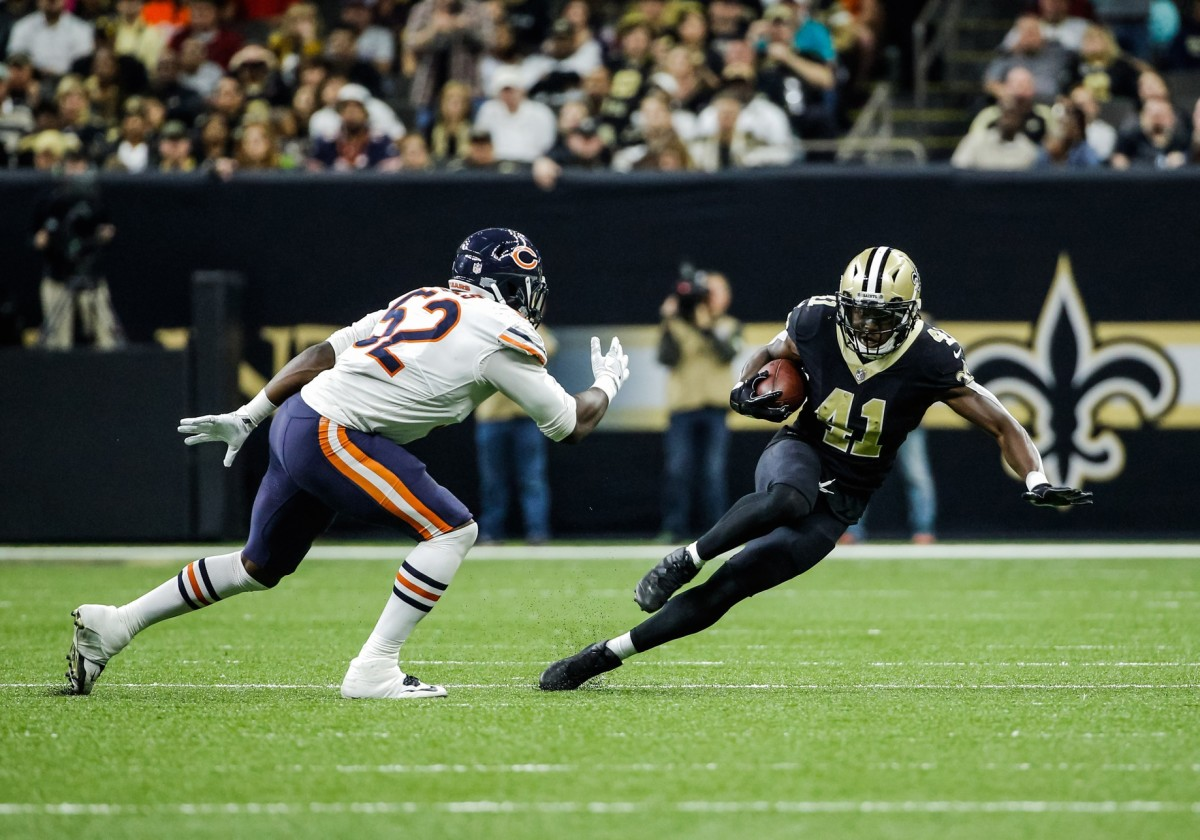 Oct 29, 2017; New Orleans, LA, USA; New Orleans Saints running back Alvin Kamara (41) runs defended by Chicago Bears linebacker Christian Jones (52) during the second half of a game at the Mercedes-Benz Superdome. The Saints defeated the Bears 20-12. Mandatory Credit: Derick E. Hingle-USA TODAY