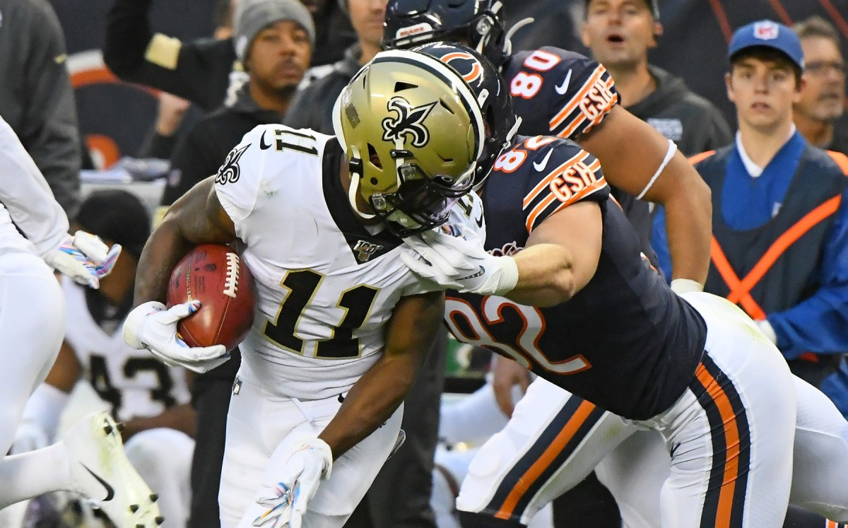 Oct 20, 2019; Chicago, IL, USA; New Orleans Saints wide receiver Deonte Harris (11) is tackled by the facemark by Chicago Bears tight end Ben Braunecker (82) on a kick off return during the second half at Soldier Field. Mandatory Credit: Mike DiNovo-USA TODAY Sports