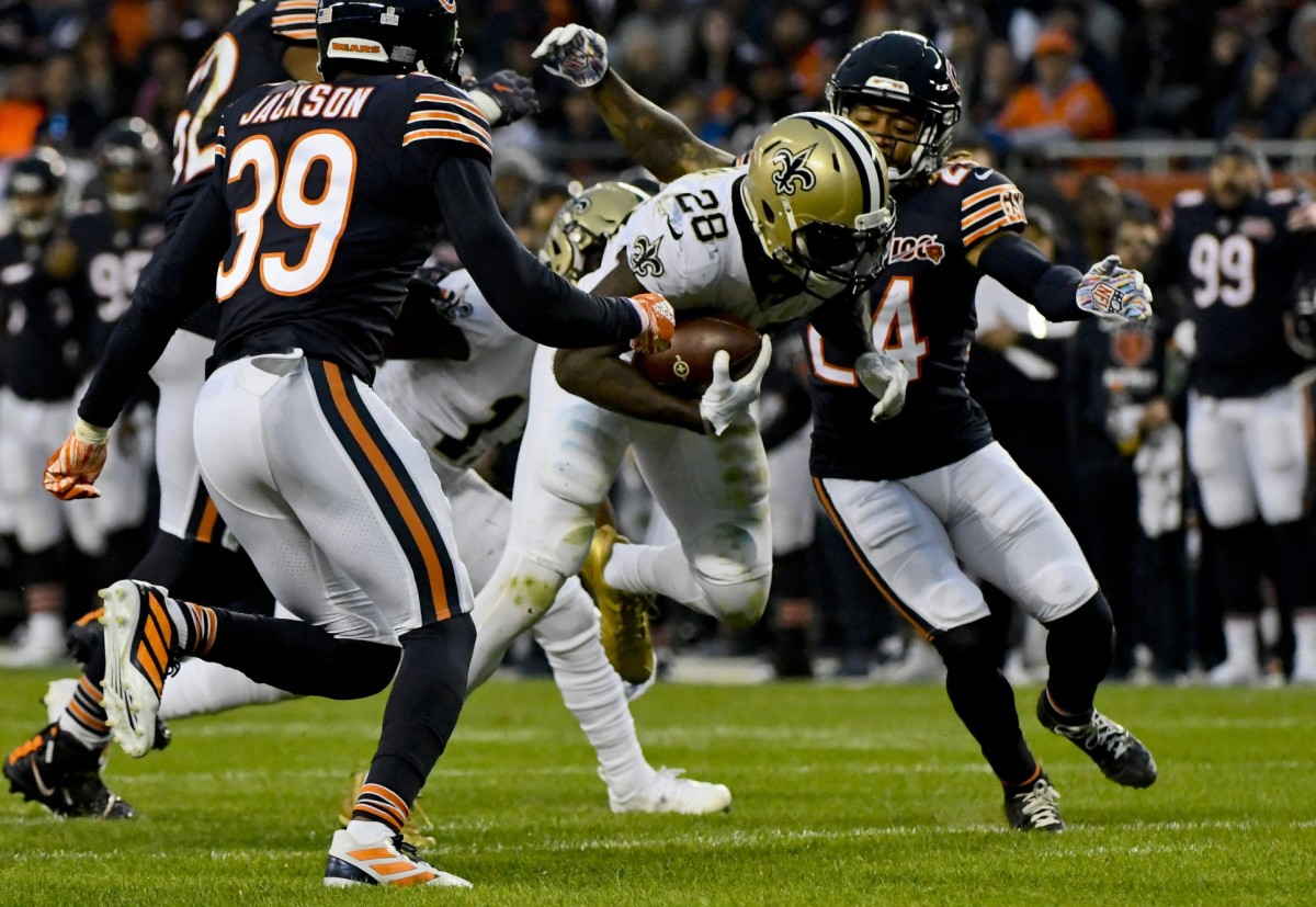 Oct 20, 2019; Chicago, IL, USA; New Orleans Saints running back Latavius Murray (28) runs against Chicago Bears free safety Eddie Jackson (39) and Chicago Bears cornerback Buster Skrine (24) during the second half at Soldier Field. Mandatory Credit: Matt Marton-USA TODAY Sports