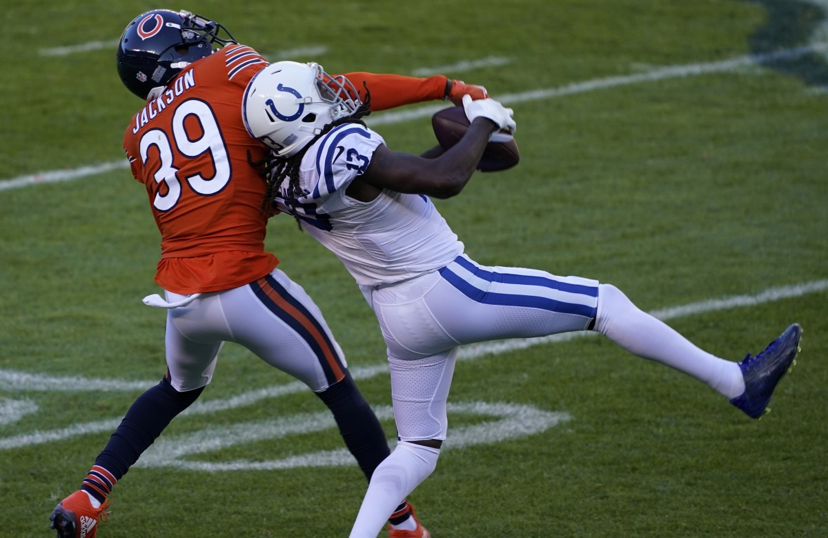 Oct 4, 2020; Chicago, Illinois, USA; Indianapolis Colts wide receiver T.Y. Hilton (13) makes a catch over Chicago Bears free safety Eddie Jackson (39) during the second quarter at Soldier Field. Mandatory Credit: Mike Dinovo-USA TODAY