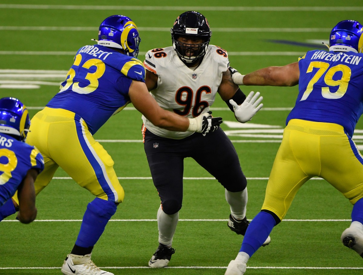 Oct 26, 2020; Inglewood, California, USA; Chicago Bears defensive end Akiem Hicks (96) tries to fight through Los Angeles Rams offensive guard Austin Corbett (63) and offensive tackle Rob Havenstein (79) during the third quarter at SoFi Stadium. Mandatory Credit: Robert Hanashiro-USA TODAY Sports