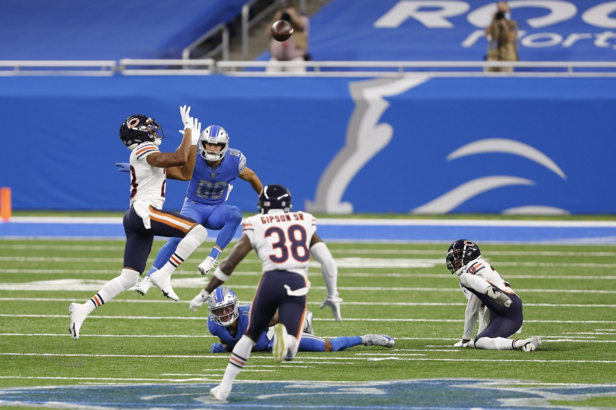 Sep 13, 2020; Detroit, Michigan, USA; Detroit Lions wide receiver Danny Amendola (80) watches as Chicago Bears cornerback Kyle Fuller (23) makes a leaping catch for an interception during the fourth quarter at Ford Field. Mandatory Credit: Raj Mehta-USA TODAY