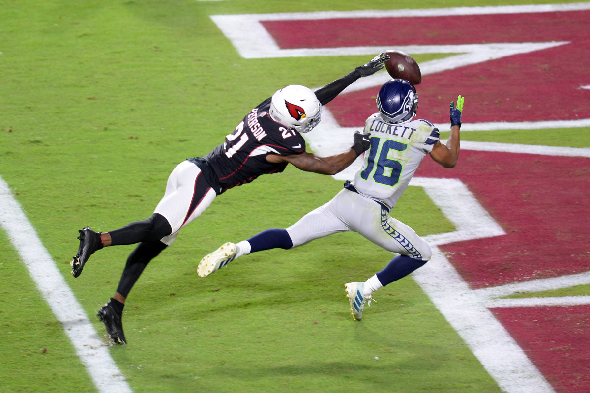 Tyler Lockett reels in a touchdown pass barely out of Cardinals cornerback Patrick Peterson's reach.