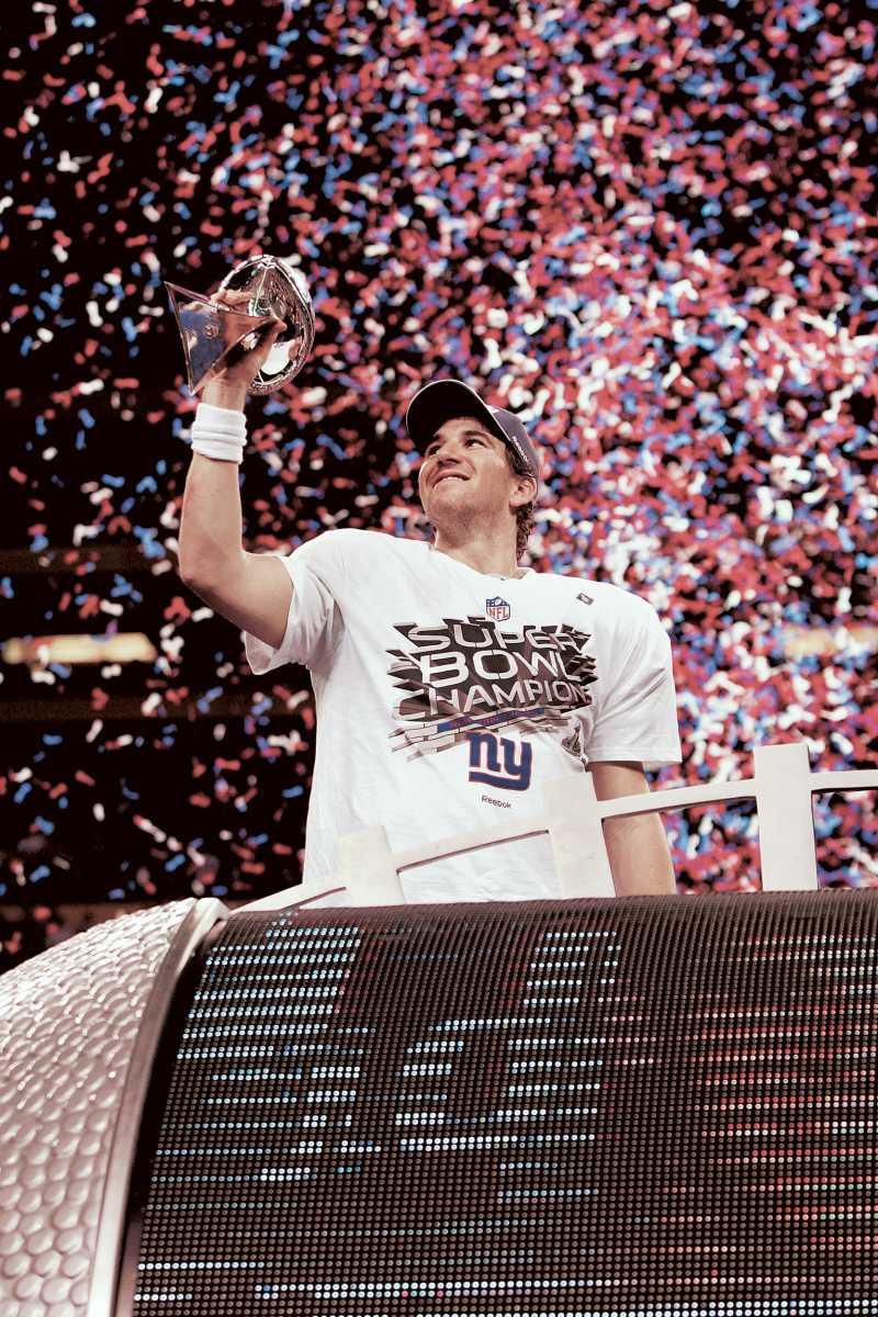 Eli Manning holding the Lombardi Trophy after being named Super Bowl XLVI's MVP.