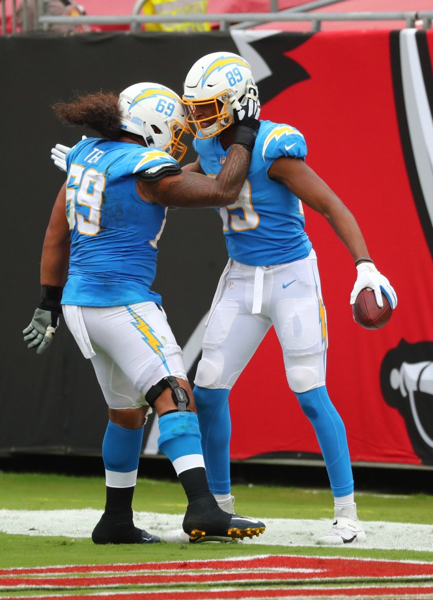 Oct 4, 2020; Tampa, Florida, USA; Los Angeles Chargers tight end Donald Parham (89) celebrates a touchdown with offensive tackle Sam Tevi (69) against the Tampa Bay Buccaneers in the second quarter of a NFL game at Raymond James Stadium.