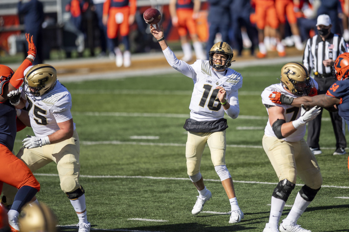 Purdue Boilermakers quarterback Aidan O'Connell (16) passes against the Illinois Fighting Illini during the first half at Memorial Stadium.