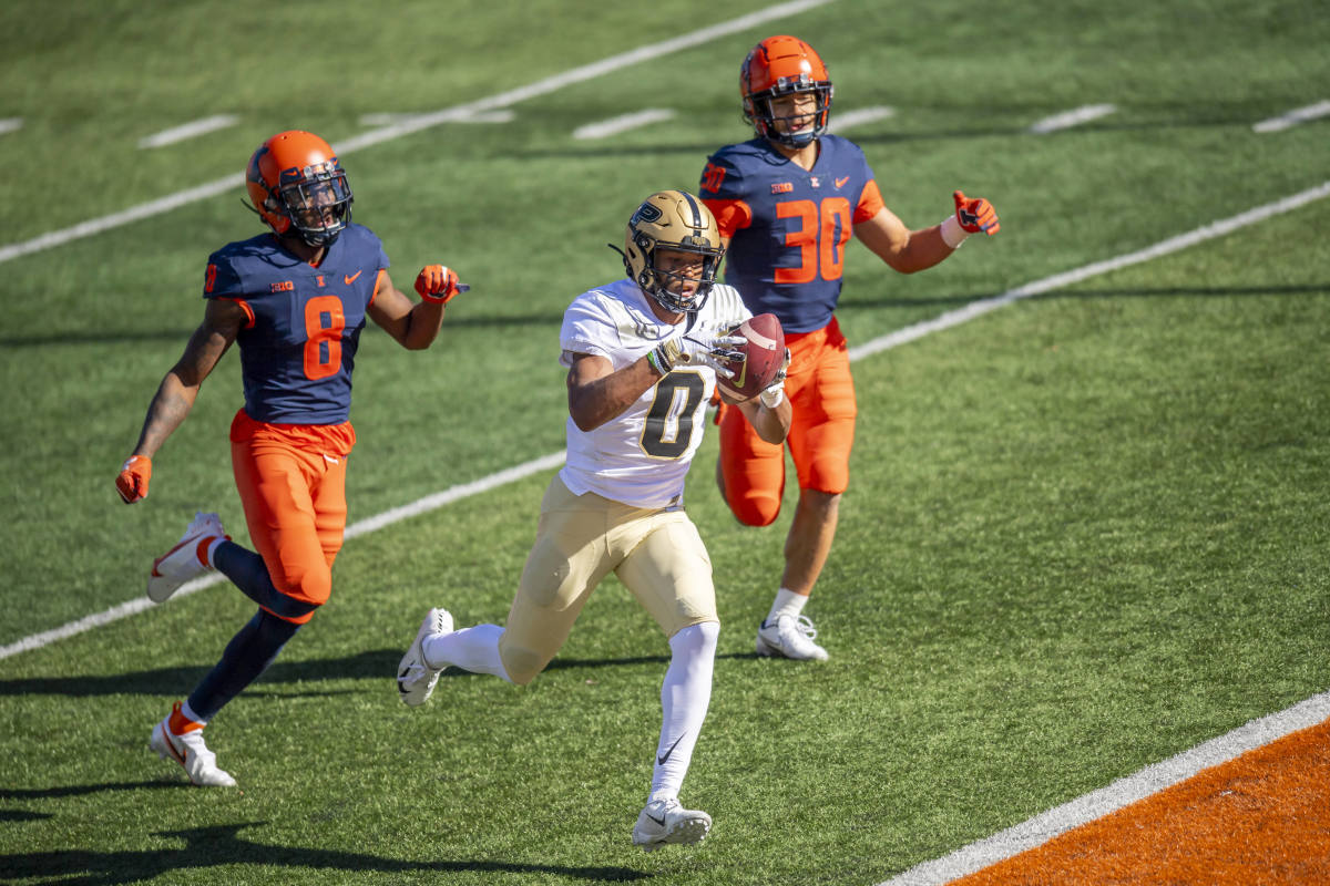 Illinois continued to struggle with its pass defense Saturday vs. Purdue as the Boilermakers finished with 371 yards through the air. Purdue wide receiver Milton Wright (0) is shown here catching a 45-yard touchdown pass over the top of Illinois secondary members Nate Hobbs and Sydney Brown.
