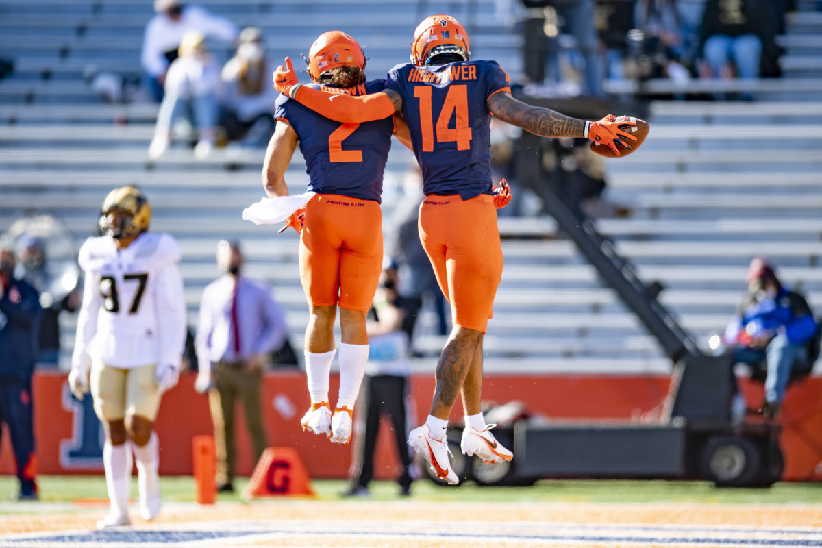 Illinois Fighting Illini wide receiver Brian Hightower (14) celebrates his touchdown with running back Chase Brown (2) during the second half at Memorial Stadium.