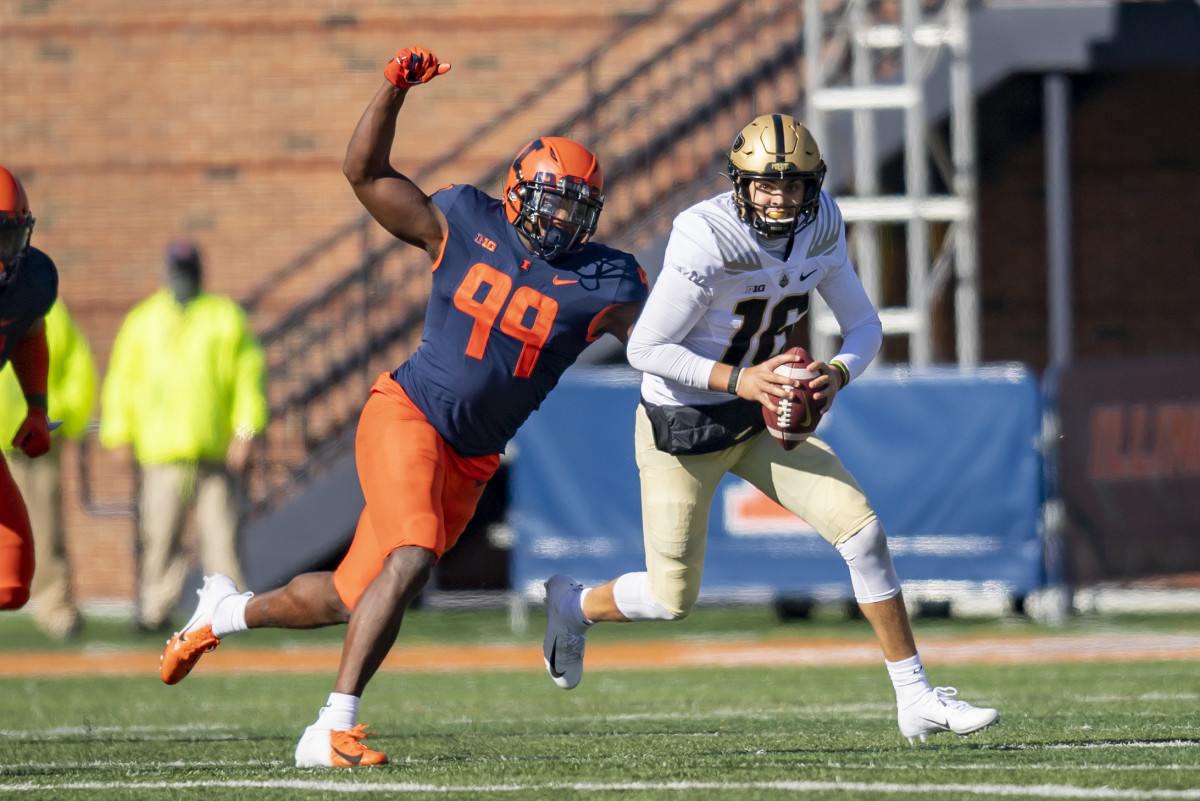 Illinois Fighting Illini defensive lineman Owen Carney Jr. (99) sacks Purdue Boilermakers quarterback Aidan O'Connell (16) during the second half at Memorial Stadium. Carney Jr., had three sacks Saturday in a 31-24 loss to Purdue.