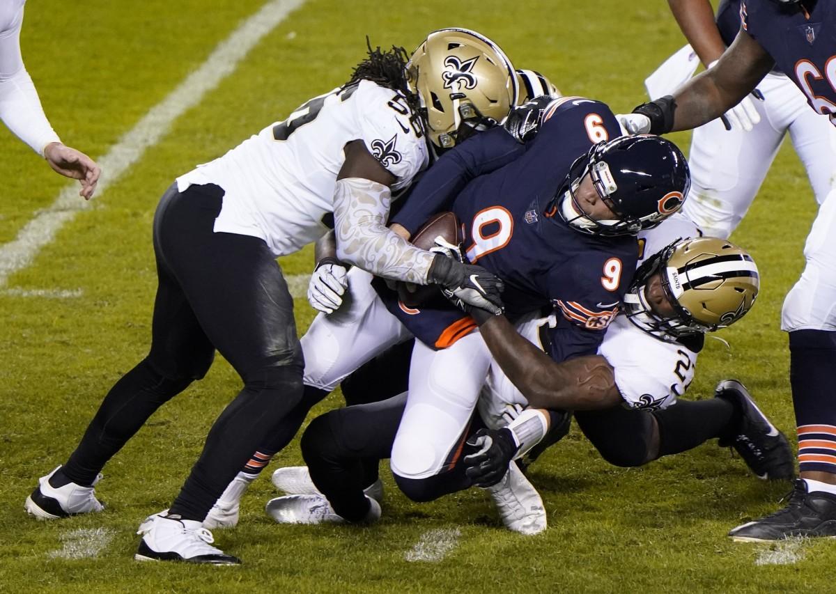 Nov 1, 2020; Chicago, Illinois, USA; New Orleans Saints outside linebacker Demario Davis (56) sacks Chicago Bears quarterback Nick Foles (9) during the third quarter at Soldier Field. Mandatory Credit: Mike Dinovo-USA TODAY